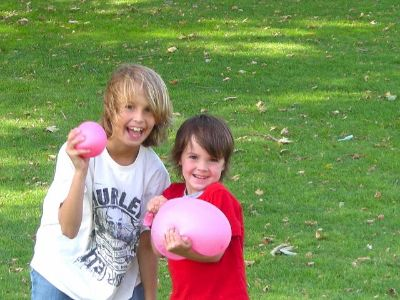 Happy Brothers With Waterballoons